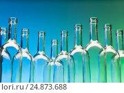 Купить «Crystal wine bottles standing in a row», фото № 24873688, снято 5 января 2016 г. (c) Сергей Новиков / Фотобанк Лори