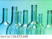 Купить «Empty glass bottles with close-up focus to necks», фото № 24873696, снято 5 января 2016 г. (c) Сергей Новиков / Фотобанк Лори