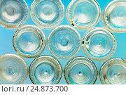 Купить «Bottoms of empty glass bottles on blue background», фото № 24873700, снято 5 января 2016 г. (c) Сергей Новиков / Фотобанк Лори