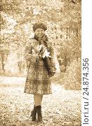 Купить «woman walking outdoors in autumn», фото № 24874356, снято 30 сентября 2010 г. (c) Яков Филимонов / Фотобанк Лори