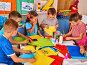 Child cutting paper in class. Development social lerning in school., фото № 24876844, снято 4 октября 2015 г. (c) Gennadiy Poznyakov / Фотобанк Лори