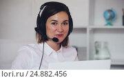 Купить «Female at call-centre», видеоролик № 24882456, снято 7 декабря 2016 г. (c) Яков Филимонов / Фотобанк Лори