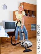 Купить «Housewife vacuuming at home», фото № 24885380, снято 17 июня 2019 г. (c) Яков Филимонов / Фотобанк Лори