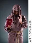 Купить «Monk in religious concept on gray background», фото № 24888108, снято 26 октября 2016 г. (c) Elnur / Фотобанк Лори