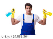 Купить «Man with cleaning agents isolated on white background», фото № 24888564, снято 31 октября 2016 г. (c) Elnur / Фотобанк Лори
