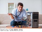Купить «Frustrated man with broken pc computer», фото № 24889316, снято 8 декабря 2016 г. (c) Elnur / Фотобанк Лори