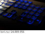 Black luminous keyboard. Illuminated computer keys close up view. Стоковое фото, фотограф Евгений Пидеркин / Фотобанк Лори