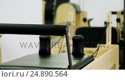 Купить «Pilates reformer in fitness studio», видеоролик № 24890564, снято 29 мая 2020 г. (c) Wavebreak Media / Фотобанк Лори