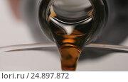 Купить «SLOW MOTION: Macro shot of pouring of a brown beverage from a glass bottle - side view», видеоролик № 24897872, снято 19 января 2017 г. (c) Евгений Киблер / Фотобанк Лори