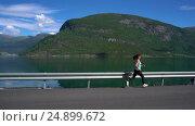 Купить «Woman jogging outdoors», видеоролик № 24899672, снято 17 октября 2016 г. (c) Андрей Армягов / Фотобанк Лори