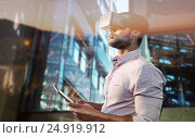 Купить «Composite image of side view of businessman holding virtual glasses and tablet computer», фото № 24919912, снято 26 мая 2019 г. (c) Wavebreak Media / Фотобанк Лори