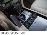 Купить «Transmission and control panel in a car interior», фото № 24921004, снято 19 октября 2013 г. (c) Мила Демидова / Фотобанк Лори