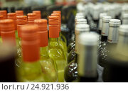 Купить «close up of bottles at liquor store», фото № 24921936, снято 2 ноября 2016 г. (c) Syda Productions / Фотобанк Лори