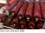Купить «salami sausage at grocery store stall», фото № 24921940, снято 2 ноября 2016 г. (c) Syda Productions / Фотобанк Лори