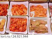 Купить «marinated meat in bowls at grocery stall», фото № 24921944, снято 2 ноября 2016 г. (c) Syda Productions / Фотобанк Лори