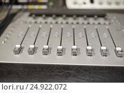 Купить «music mixing console at sound recording studio», фото № 24922072, снято 18 августа 2016 г. (c) Syda Productions / Фотобанк Лори