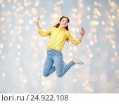 Купить «smiling young woman jumping in air», фото № 24922108, снято 29 октября 2016 г. (c) Syda Productions / Фотобанк Лори