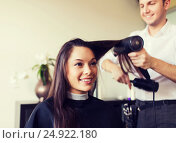 Купить «happy woman with stylist making hairdo at salon», фото № 24922180, снято 15 февраля 2015 г. (c) Syda Productions / Фотобанк Лори