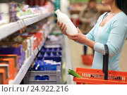 Купить «woman with milk bottle at grocery or supermarket», фото № 24922216, снято 2 ноября 2016 г. (c) Syda Productions / Фотобанк Лори