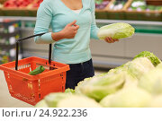 Купить «woman with basket and chinese cabbage at grocery», фото № 24922236, снято 2 ноября 2016 г. (c) Syda Productions / Фотобанк Лори
