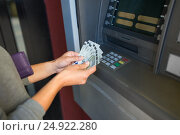Купить «close up of hand withdrawing money at atm machine», фото № 24922280, снято 8 сентября 2016 г. (c) Syda Productions / Фотобанк Лори