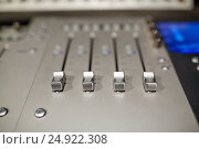 Купить «music mixing console at sound recording studio», фото № 24922308, снято 18 августа 2016 г. (c) Syda Productions / Фотобанк Лори