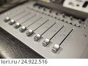 Купить «music mixing console at sound recording studio», фото № 24922516, снято 18 августа 2016 г. (c) Syda Productions / Фотобанк Лори