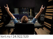Купить «man at mixing console in music recording studio», фото № 24922520, снято 18 августа 2016 г. (c) Syda Productions / Фотобанк Лори