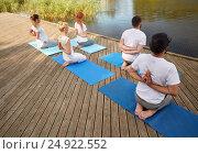 Купить «group of people making yoga exercises outdoors», фото № 24922552, снято 7 августа 2016 г. (c) Syda Productions / Фотобанк Лори