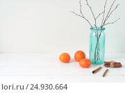 Купить «Minimal elegant composition with tangerines and vase», фото № 24930664, снято 15 октября 2018 г. (c) Екатерина Рыбина / Фотобанк Лори