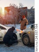 Купить «Man calling to car assistance after crash», фото № 24937164, снято 15 января 2017 г. (c) Pavel Biryukov / Фотобанк Лори