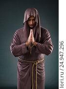 Купить «Monk in religious concept on gray background», фото № 24947296, снято 26 октября 2016 г. (c) Elnur / Фотобанк Лори