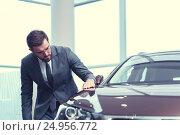 Купить «Businessman with a car», фото № 24956772, снято 7 октября 2016 г. (c) Raev Denis / Фотобанк Лори