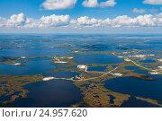 Купить «Нефтяное месторождение в Западной Сибири, вид сверху», фото № 24957620, снято 29 июня 2008 г. (c) Владимир Мельников / Фотобанк Лори