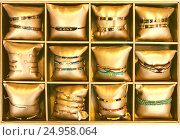 Купить «bracelets in bijouterie store», фото № 24958064, снято 19 сентября 2018 г. (c) Яков Филимонов / Фотобанк Лори