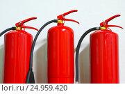 Red fire extinguishers. Fire-fighting equipment. Стоковое фото, фотограф yeti / Фотобанк Лори