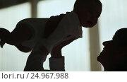 Купить «Silhouette Loving mother playing with her baby in home», видеоролик № 24967988, снято 20 января 2017 г. (c) Mikhail Davidovich / Фотобанк Лори