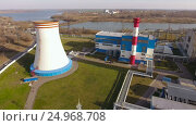 Купить «Modern thermal power station with a large cooling tower near the river. Russia. 4K», видеоролик № 24968708, снято 17 января 2017 г. (c) ActionStore / Фотобанк Лори