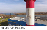 Купить «Modern thermal power station with a large cooling tower near the river. 4K», видеоролик № 24968860, снято 17 января 2017 г. (c) ActionStore / Фотобанк Лори