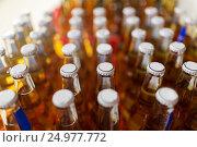 Купить «close up of bottles at liquor store», фото № 24977772, снято 2 ноября 2016 г. (c) Syda Productions / Фотобанк Лори