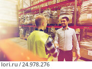 worker and businessmen with clipboard at warehouse, фото № 24978276, снято 9 декабря 2015 г. (c) Syda Productions / Фотобанк Лори