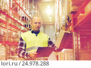Купить «man with clipboard in safety vest at warehouse», фото № 24978288, снято 9 декабря 2015 г. (c) Syda Productions / Фотобанк Лори