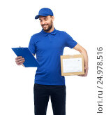 Купить «happy delivery man with parcel box and clipboard», фото № 24978516, снято 3 декабря 2016 г. (c) Syda Productions / Фотобанк Лори