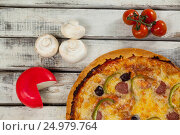 Купить «Italian pizza on wooden plank with vegetables and cheese», фото № 24979764, снято 30 сентября 2016 г. (c) Wavebreak Media / Фотобанк Лори