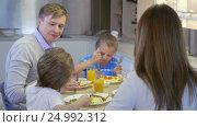 Купить «Young family with children at home», видеоролик № 24992312, снято 19 сентября 2019 г. (c) Raev Denis / Фотобанк Лори