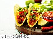Купить «Mexican nachos chips and tacos with meat, beans and salsa», фото № 24999632, снято 8 декабря 2016 г. (c) Наталия Кленова / Фотобанк Лори