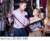 Купить «Adult man and woman choosing bdsm accessories», фото № 25001340, снято 23 марта 2019 г. (c) Яков Филимонов / Фотобанк Лори