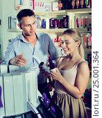 Купить «Portrait of adult couple choosing erotic toys», фото № 25001364, снято 23 марта 2019 г. (c) Яков Филимонов / Фотобанк Лори