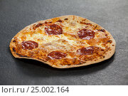 Купить «Delicious italian pizza served on grey background», фото № 25002164, снято 30 сентября 2016 г. (c) Wavebreak Media / Фотобанк Лори