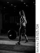 Купить «Strong girl throw down barbell after exercise», фото № 25025724, снято 11 сентября 2016 г. (c) Pavel Biryukov / Фотобанк Лори